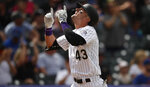 Colorado Rockies' Sam Hilliard gestures as he crosses home plate after hitting a solo home run off New York Mets starting pitcher Noah Syndergaard in the fourth inning of a baseball game Wednesday, Sept. 18, 2019, in Denver. (AP Photo/David Zalubowski)