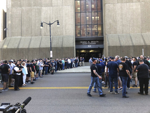 In this photo provided by WKBW, supporters of two suspended Buffalo police officers assemble outside the courthouse in Buffalo, N.Y., Saturday, June 6, 2020. According to prosecutors, both officers were charged with assault Saturday, after a video showed them shoving a 75-year-old protester in a recent demonstration over the death of George Floyd. (Madison Carter/WKBW via AP)