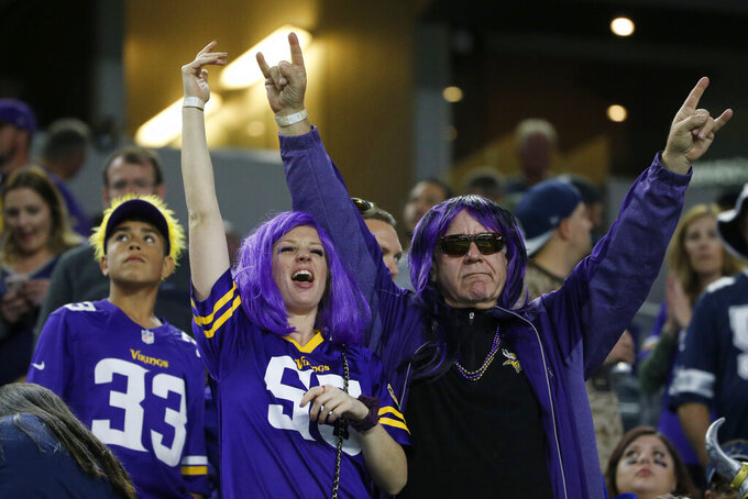 Minnesota Vikings fans cheer on the team during the second half of an NFL football game against the Dallas Cowboys in Arlington, Texas, Sunday, Nov. 10, 2019. (AP Photo/Michael Ainsworth)