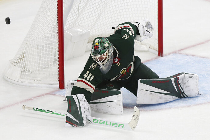 Minnesota Wild's Devan Dubnyk (4)0 blocks the puck from the net in the third period of an NHL hockey game against the Montreal Canadiens, Sunday Oct. 20, 2019, in St. Paul, Minn. (AP Photo/Stacy Bengs)