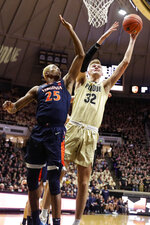 Purdue center Matt Haarms (32) shoots next to Virginia forward Mamadi Diakite (25) during the second half of an NCAA college basketball game in West Lafayette, Ind., Wednesday, Dec. 4, 2019. Purdue won 69-40. (AP Photo/Michael Conroy)