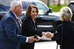 Rep. Nancy Pelosi, D-Calif., middle, and former Rep. Harry Mitchell, D-Ariz., left, shake hands with another person as they arrive for the funeral of former Democratic U.S. Rep. Ed Pastor Friday, Dec. 7, 2018, in Phoenix. Pastor was Arizona's first Hispanic member of Congress, spending 23 years in Congress before retiring in 2014. Pastor passed away last week at the age of 75. (AP Photo/Ross D. Franklin)