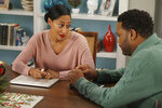 This image released by ABC shows Tracee Ellis Ross, left, and Anthony Anderson in a scene from