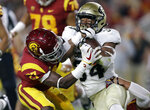 Colorado running back Travon McMillian, right, is tackled by Southern California cornerback Ajene Harris during the first half of an NCAA college football game Saturday, Oct. 13, 2018, in Los Angeles. (AP Photo/Marcio Jose Sanchez)