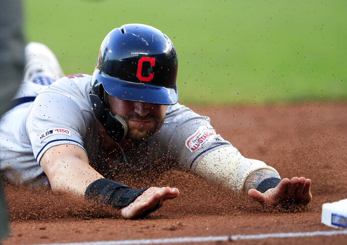 Cleveland Indians' Tyler Naquin slides into third base during the third inning of the team's baseball game against the Kansas City Royals at Kauffman Stadium in Kansas City, Mo., Tuesday, July 2, 2019. Naquin advanced from first on a single by Francisco Lindor. (AP Photo/Orlin Wagner)
