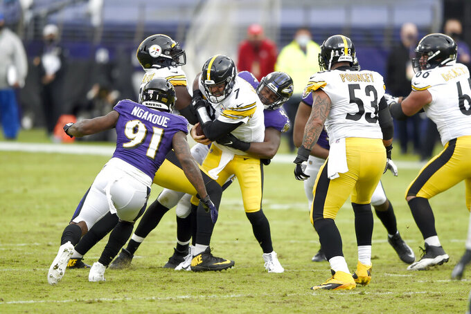 Baltimore Ravens linebacker Jaylon Ferguson, right, sacks Pittsburgh Steelers quarterback Ben Roethlisberger (7) during the second half of an NFL football game, Sunday, Nov. 1, 2020, in Baltimore. (AP Photo/Gail Burton)