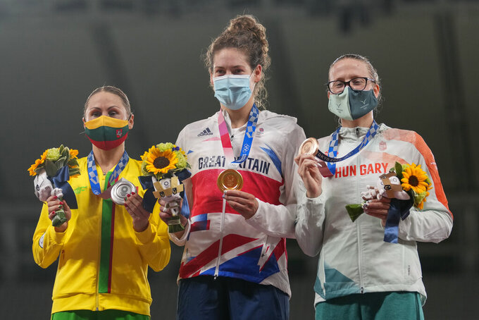 From left, silver medal Laura Asadauskaite of Lithuania, gold medal Kate French of Great Britain and Sarolta Kovacs of Hungary celebrate on the podium of the women's modern pentathlon at the 2020 Summer Olympics, Friday, Aug. 6, 2021, in Tokyo, Japan. (AP Photo/Andrew Medichini)