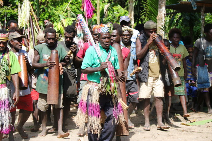 In this Nov. 29, 2019, photo, the Teau Community celebrates the Upe voting in the Bougainville referendum in Teau, Bougainville, Papua New Guinea. All across the Pacific region of Bougainville, people have been voting in a historic referendum to decide if they want to become the world's newest nation by gaining independence from Papua New Guinea. (Jeremy Miller, Bougainville Referendum Commission via AP)