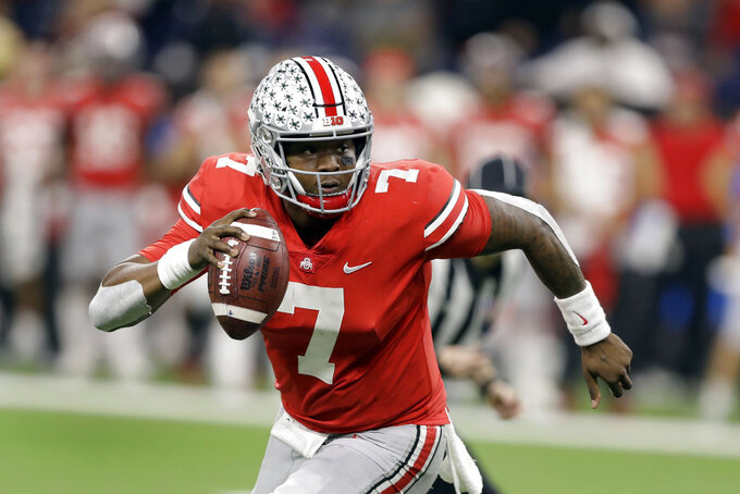 Haskins, Bush receive top honors on AP All-Big Ten team