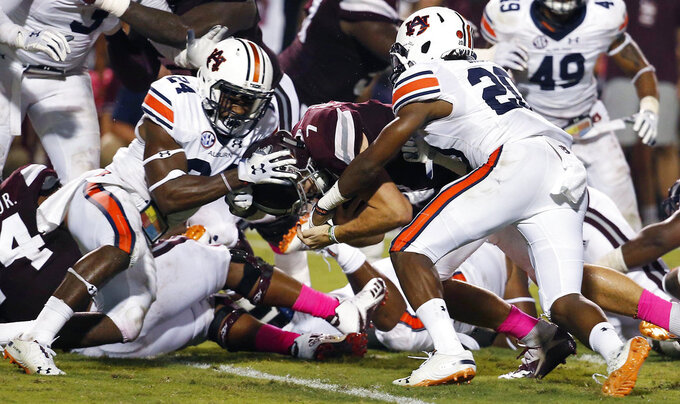 Auburn defensive backs Daniel Thomas (24) and Jeremiah Dinson (20) fail from keeping Mississippi State quarterback Nick Fitzgerald (7) from scoring on a one-yard dive into the end zone during the first half of their NCAA college football game in Starkville, Miss., Saturday, Oct. 6 2018. (AP Photo/Rogelio V. Solis)