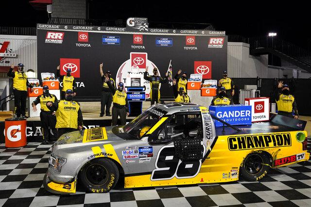Grant Enfinger, top center, celebrates after winning a NASCAR Truck Series auto race Thursday, Sept. 10, 2020, in Richmond, Va. (AP Photo/Steve Helber)