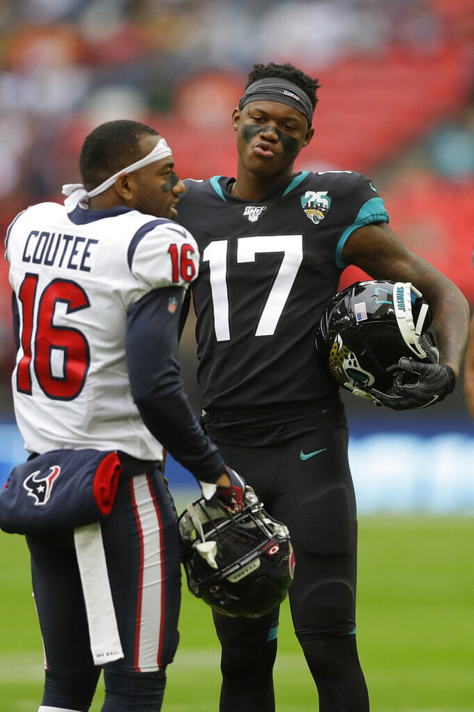 Jacksonville Jaguars wide receiver D.J. Chark (17) speaks with Houston Texans wide receiver Keke Coutee (16) ahead of an NFL football game at Wembley Stadium, Sunday, Nov. 3, 2019, in London. (AP Photo/Kirsty Wigglesworth)