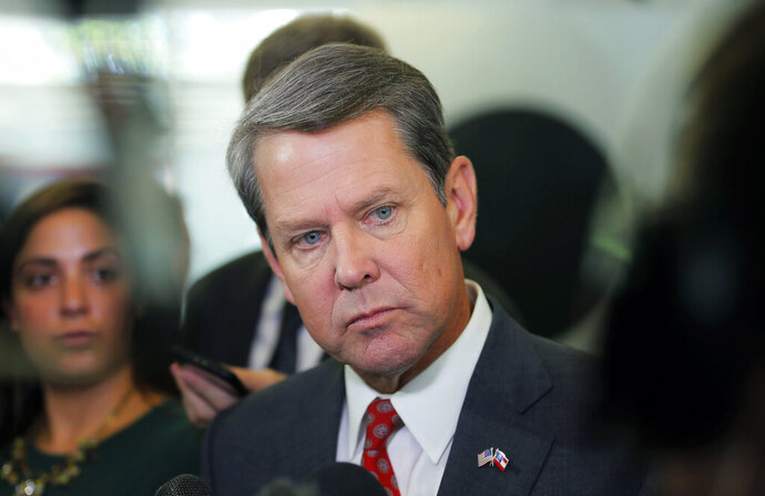 FILE - In this Wednesday, Aug. 29, 2018, file photo, Georgia Secretary of State Brian Kemp addresses the media at a news conference at his Atlanta headquarters. Kemp will soon get to appoint a replacement for three-term U.S. Sen. Johnny Isakson, who announced that he's stepping down in December 2019 due to health issues. (Bob Andres/Atlanta Journal-Constitution via AP, File)