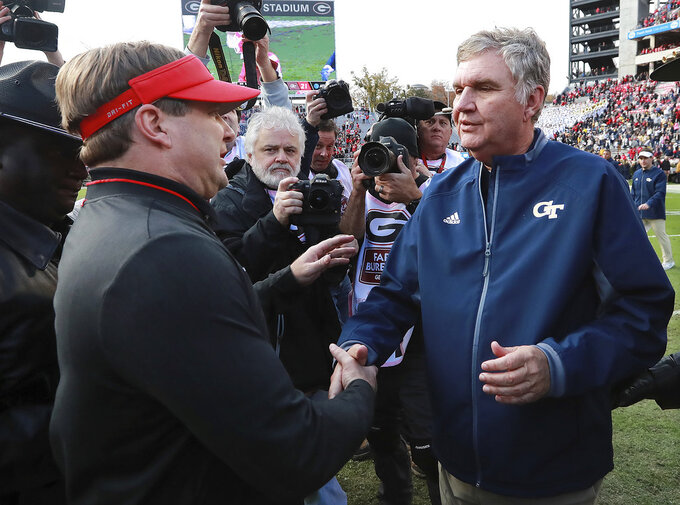 Georgia Tech head coach Paul Johnson, left, and Georgia head coach Kirby Smart meet at after an NCAA college football game, Saturday, Nov. 24, 2018, in Athens, Ga. Georgia won 45-21. (Curtis Compton/Atlanta Journal Constitution via AP)