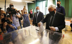 Poland's main ruling party leader Jaroslaw Kaczynski casts his vote during presidential election in Warsaw, Poland, Sunday, June 28, 2020. The election will test the popularity of incumbent President Andrzej Duda who is seeking a second term and of the conservative ruling party that backs him. (AP Photo/Petr David Josek)