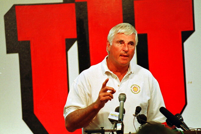 FILE - Indiana University basketball coach Bobby Knight gestures during a news conference in Bloomington, Ind., in this Wednesday, June 16, 1999, file photo. Tony Hinkle turned Butler's pass-and-cut offense of the 1920s into a coaching textbook for generations. Bob Knight and Gene Keady added their own revisions following Hinkle's forced retirement in 1970. Today, those three remain the gold standard of basketball innovation in Indiana, a state where successful coaches have spent more than a century testing novel concepts, breaking barriers and polishing philosophies before introducing them America.(AP Photo/Chuck Robinson, File)