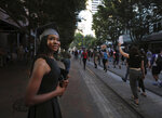 In this May 31, 2020, photo, recent Northwest Community College graduate Nyaisha Doyle cheers on demonstrators marching down Main Street, Memphis, protesting the death of George Floyd in Minneapolis police custody May 25, 2020. (Patrick Lantrip/Daily Memphian via AP)