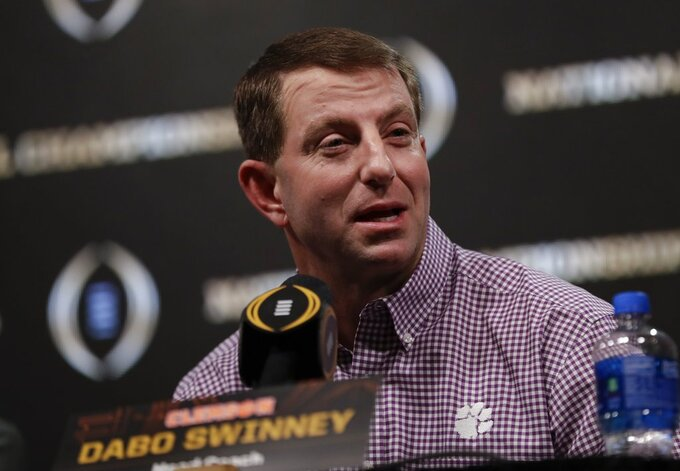 Clemson head coach Dabo Swinney answers questions at a news conference for the NCAA college football playoff championship game Tuesday, Jan. 8, 2019, in San Jose, Calif. (AP Photo/David J. Phillip)