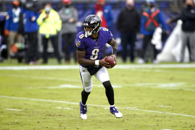 Baltimore Ravens quarterback Lamar Jackson rolls out looking to pass against the Pittsburgh Steelers during the first half of an NFL football game, Sunday, Nov. 1, 2020, in Baltimore. (AP Photo/Gail Burton)