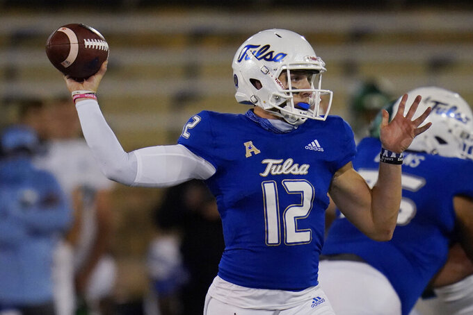 Tulsa quarterback Seth Boomer (12) throws a pass during the first half of the team's NCAA college football game against Tulane in Tulsa, Okla., Thursday, Nov. 19, 2020. (AP Photo/Sue Ogrocki)