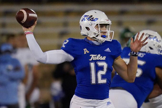 Tulsa quarterback Seth Boomer (12) throws a pass during the first half of the team's NCAA college football game against Tulane in Tulsa, Okla., Thursday, Nov. 19, 2020. (AP Photo/Sue Ogrocki)