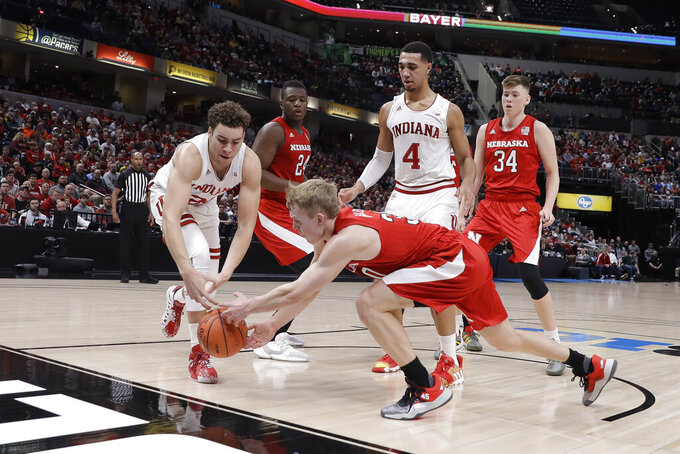 Indiana's Race Thompson (25) and Nebraska's Charlie Easley (30) battle for a loose ball during the first half of an NCAA college basketball game at the Big Ten Conference tournament, Wednesday, March 11, 2020, in Indianapolis. (AP Photo/Darron Cummings)