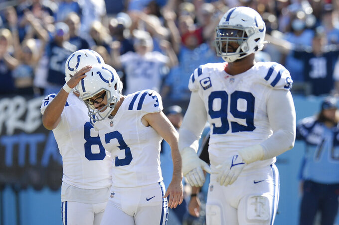 Indianapolis Colts kicker Rodrigo Blankenship (3) gets a pat on the helmet by holder Rigoberto Sanchez (8) after Blankenship missed a 51-yard field goal against the Tennessee Titans in the second half of an NFL football game Sunday, Sept. 26, 2021, in Nashville, Tenn. The Titans won 25-16. (AP Photo/Mark Zaleski)