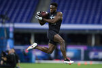 FILE - In this March 1, 2020, file photo, Auburn defensive back Noah Igbinoghene runs a drill at the NFL football scouting combine in Indianapolis. The Miami Dolphins selected Igbinoghene in the first round of the NFL draft. (AP Photo/Michael Conroy, File)