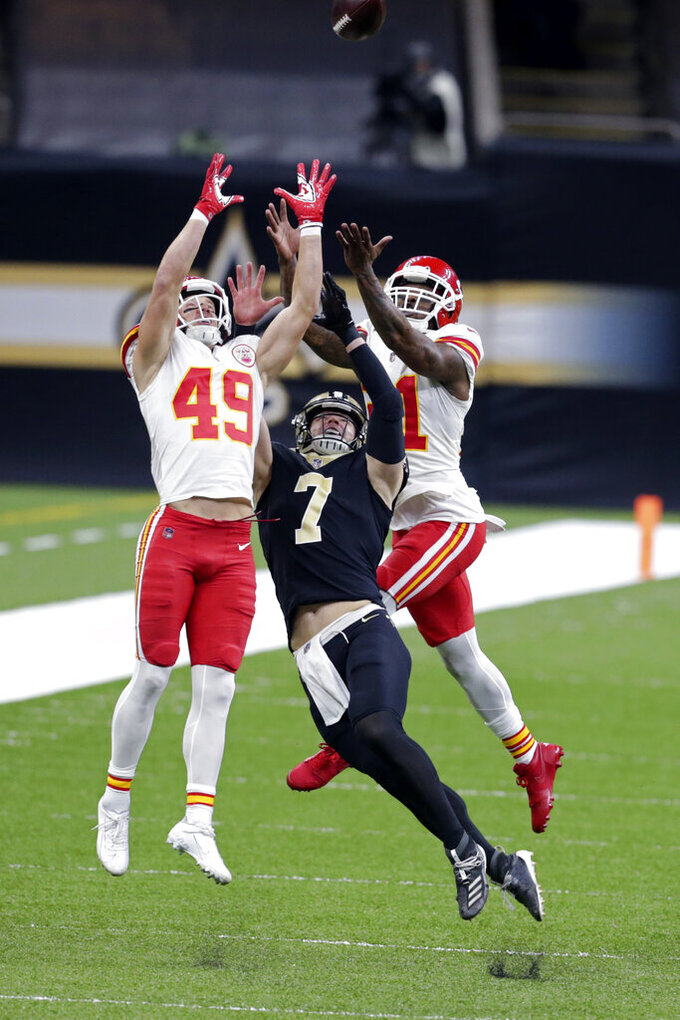 Kansas City Chiefs free safety Daniel Sorensen (49) and cornerback Bashaud Breeland (21) break up a pass intended for New Orleans Saints Taysom Hill (7) in the first half of an NFL football game in New Orleans, Saturday, Dec. 19, 2020. (AP Photo/Butch Dill)