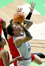 Memphis guard Lester Quinones (11) shoots over Dayton guard Koby Brea (4) in the second half of an NCAA college basketball game in the first round of the NIT Tournament, Saturday, March 20, 2021, in Denton, Texas. Memphis won 71-60. (AP Photo/Matt Strasen)