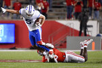 BYU wide receiver Dax Milne (5) is tackled by Houston linebacker Donavan Mutin during the first half of an NCAA college football game, Friday, Oct. 16, 2020, in Houston. (AP Photo/Eric Christian Smith)