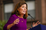 """New York Gov. Kathy Hochul wears a necklace with the word """"vaxed"""" as she speaks during an event in the Harlem neighborhood of New York, Thursday, Aug. 26, 2021. Hochul has selected Brian Benjamin, a state senator from New York City, as her choice for lieutenant governor. (AP Photo/Mary Altaffer)"""