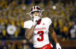 Indiana wide receiver Ty Fryfogle celebrates his seven-yard touchdown reception in the first half of an NCAA college football game against Michigan in Ann Arbor, Mich., Saturday, Nov. 17, 2018. (AP Photo/Paul Sancya)