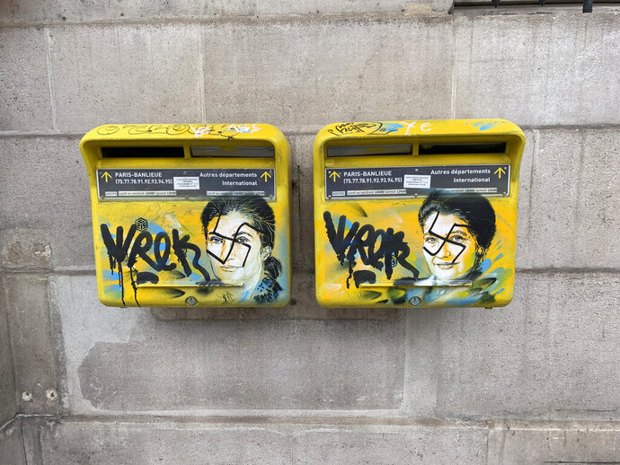 This photo taken on Monday, Feb. 11, 2019 and provided by the Paris city hall of the XIIIth district shows mailboxes with swastikas covering the face of the late Holocaust survivor and renowned French politician, Simone Veil, in Paris, France. According to French authorities, the total of registered anti-Semitic acts rose to 541 in 2018 from 311 in 2017, a rise of 74 percent. (Mairie du XIIIth via AP)