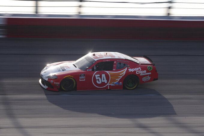 Denny Hamlin races in a NASCAR Xfinity Series auto race Saturday, Sept. 4, 2021, in Darlington, S.C. (AP Photo/John Amis)