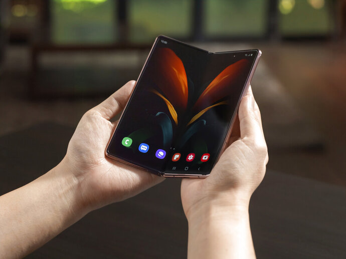 In this undated photo provided by Samsung, Samsung's foldable phone is displayed. Samsung's second attempt at a foldable smartphone will come with a $2,000 price tag and a few elite perks aimed at affluent consumers still able to afford the finer things in life during tough times. The phone, dubbed the Z Fold2, will include a VIP package that will provide access to fancy restaurants and golf clubs to supplement the device's multipurpose design. (Samsung via AP)
