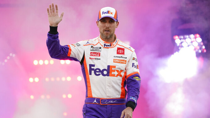 Denny Hamlin waves to the crowd during driver introductions prior to the start of the NASCAR Cup series auto race in Richmond, Va., Saturday, Sept. 11, 2021. (AP Photo/Steve Helber)