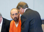FILE - In this March 14, 2017, file photo, Craig Hicks, center, charged with the murder of three Muslim students in Chapel Hill, N.C., listens to with attorney Steve Freedman as he makes an appearance in a Durham County courtroom in Durham, N.C. Hicks is expected Wednesday, June 12, 2019, to enter a plea in court in Durham, more than four years after the slayings, which the victims' families blamed on bigotry.  (Chris Seward/The News & Observer via AP, FIle)