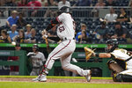 Arizona Diamondbacks' Christian Walker (53) drives in three runs in front of Pittsburgh Pirates catcher Jacob Stallings, right, with a bases-loaded single in the fifth inning of a baseball game, Monday, Aug. 23, 2021, in Pittsburgh. (AP Photo/Keith Srakocic)