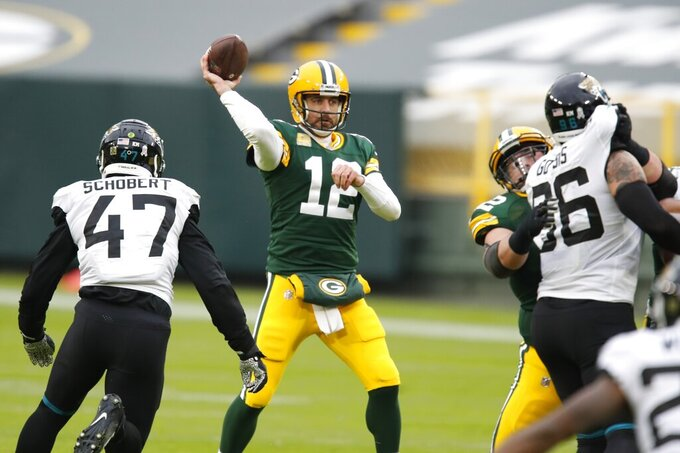 Green Bay Packers' Aaron Rodgers throws during the first half of an NFL football game against the Jacksonville Jaguars Sunday, Nov. 15, 2020, in Green Bay, Wis. (AP Photo/Matt Ludtke)