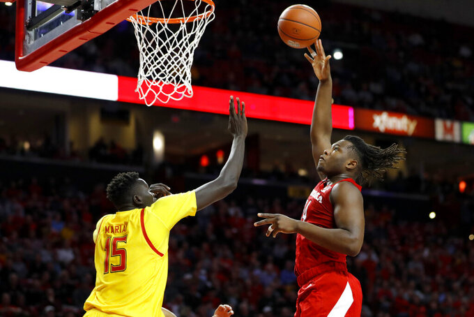 Nebraska forward Yvan Ouedraogo, right, goes up for a shot against Maryland center Chol Marial (15) during the first half of an NCAA college basketball game, Tuesday, Feb. 11, 2020, in College Park, Md. (AP Photo/Julio Cortez)
