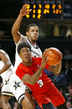 SMU guard Kendric Davis (3) drives in front of Vanderbilt guard Jordan Wright during the second half of an NCAA college basketball game Saturday, Jan. 4, 2020, in Nashville, Tenn. (AP Photo/Mark Humphrey)