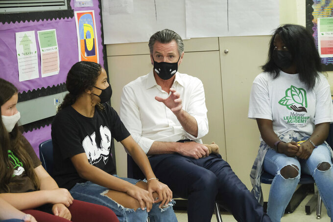 Gov. Gavin Newsom meets with students at Melrose Leadership Academy, a TK-8 school in Oakland, Calif., on Wednesday, Sept. 15, 2021, one day after defeating a Republican-led recall effort. (AP Photo/Nick Otto)