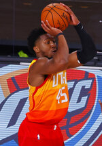 Utah Jazz's Donovan Mitchell shoots a 3-point basket against the Denver Nuggets during the fourth quarter of Game 4 of an NBA basketball first-round playoff series, Sunday, Aug. 23, 2020, in Lake Buena Vista, Fla. (Kevin C. Cox/Pool Photo via AP)
