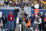 West Virginia quarterback Jack Allison (11) attempts a pass during the second half of an NCAA college football game against Iowa State, Saturday, Oct. 12, 2019, in Morgantown, W.Va. (AP Photo/Raymond Thompson)