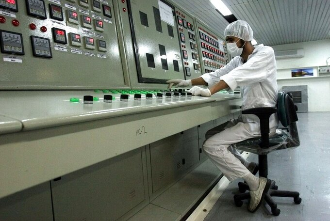 """FILE - In this Feb. 3, 2007 file photo, a technician works at the Uranium Conversion Facility just outside the city of Isfahan, Iran, 255 miles (410 kilometers) south of the capital Tehran. The United Nations' atomic watchdog says Iran has enriched uranium to slightly higher purity than previously thought due to """"fluctuations"""" in the process in a report that underscores the challenges diplomats face in ongoing talks to bring the United States back into the nuclear deal with Tehran. (AP Photo/Vahid Salemi, File)"""