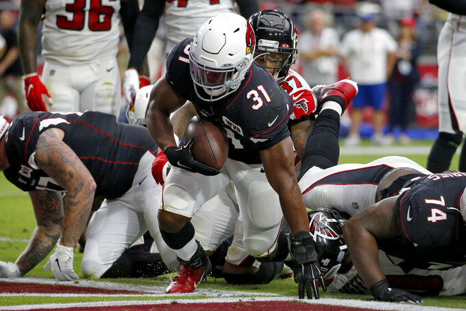 Arizona Cardinals running back David Johnson (31) scores a touchdown against the Atlanta Falcons during the first half of an NFL football game, Sunday, Oct. 13, 2019, in Glendale, Ariz. (AP Photo/Ross D. Franklin)