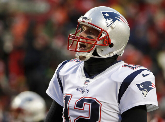 New England Patriots quarterback Tom Brady (12) shouts as he warms up before the AFC Championship NFL football game against the Kansas City Chiefs, Sunday, Jan. 20, 2019, in Kansas City, Mo. (AP Photo/Elise Amendola)
