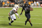 South Carolina running back Kevin Harris (20) carries for a touchdown, next to Tennessee linebacker Deandre Johnson (13) during the first half of an NCAA college football game Saturday, Sept. 26, 2020, in Columbia, S.C. (AP Photo/Sean Rayford)
