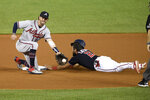 Washington Nationals' Adam Eaton steals second against Atlanta Braves shortstop Dansby Swanson, left, during the eighth inning of a baseball game, Saturday, Sept. 12, 2020, in Washington.  (AP Photo/Nick Wass)